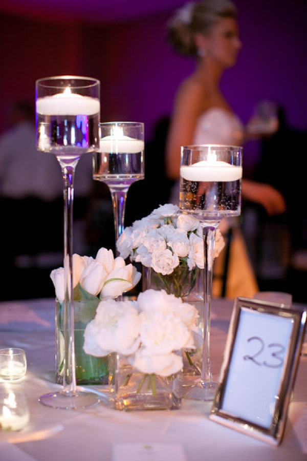 White flower centerpieces with candles imgkid