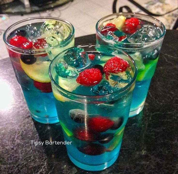 A NIGHT TO REMEMBER 1/2 oz. (15 ml) Raspberry Vodka 1/2 oz. (15 ml) Citrus Vodka 1/2 oz. (15 ml) Blueberry Vodka 1/2 oz. (15 ml) Blue Curacao 1 oz. (30 ml) Sweet & Sour 2 oz. (60 ml) Raspberry Lemonade Raspberries  Lemons