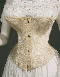 Women's Corset    Probably made in United States  c. 1860-70s    Artist/maker unknown, American?    White silk moiré; baleen (whalebone); metal busk    Currently not on view