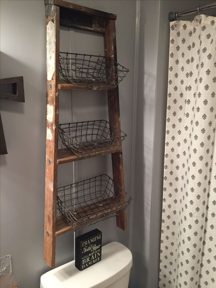 Old ladder turned into above bathroom storage!! I got a ladder out of the garbage bought some wire baskets and boom amazing storage in a small bathroom!!