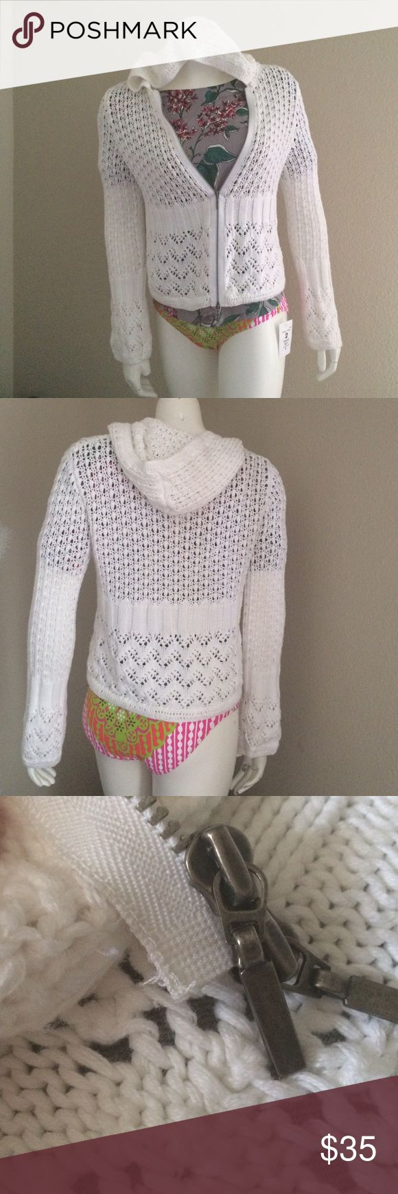 Cabi crochet zip up hoodie sweater In good used condition. White 100% cotton crochet hoodie. Only flaw is the zipper has a little un treading at the bottom and 1 pull on the inside bodice as shown in pics. Price reflects flaws. CAbi Tops Sweatshirts & Hoodies