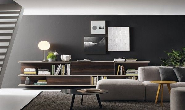 Lovely use of grey in the living room to complement the trendy wall unit