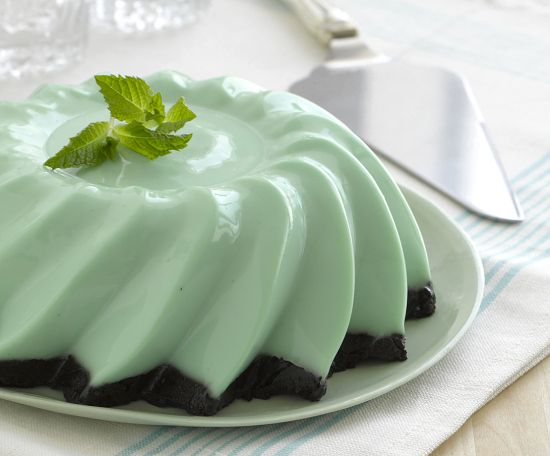 Grasshopper Layer Jell-O  Ingredients: 2 tbsp(2 envelopes) of unflavored gelatin powder,1/2 cup cold water,1/2 cup boiling water,1 1/2 cups (14 ounce can) sweetened condensed milk,1 1/2 cup crème de menthe,1/2 cup sour cream,3 or 4 drops green food dye (optional)  Crust layer:1 tbsp(1 envelopes) of unflavored gelatin powder,3/4 cup milk,1 1/2 cup crushed chocolate cookie crumbs.Read more for directions...  http://jellomoldmistress.com/2012/12/03/grasshopper-pie-2/#more-3433
