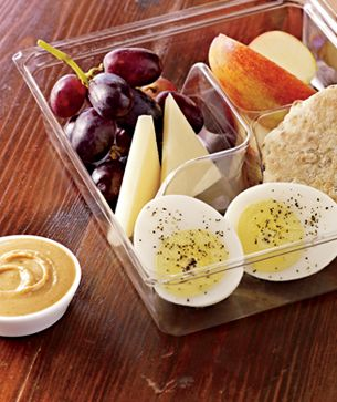 Protein Bistro Box-Cage-free egg, white Cheddar cheese, honey peanut butter spread, multigrain muesli bread, apples and grapes.