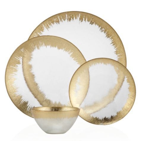 Sunia's Comments: Solaris Dinnerware - Sets of 4 from Z Gallerie. My favorite part about these pieces is the metallic perimeter.