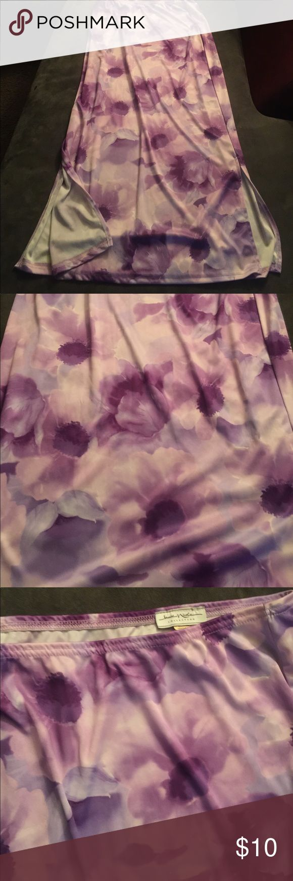 Purple Long Floral Maxi Skirt Summer long Floral Maxi Skirt made of polyester. Elastic waistband, two kick plates on each side.  If you want to feel relaxed and free flowing then this skirt is for you.  Great to wear with your favorite t-shirt. Skirts Maxi