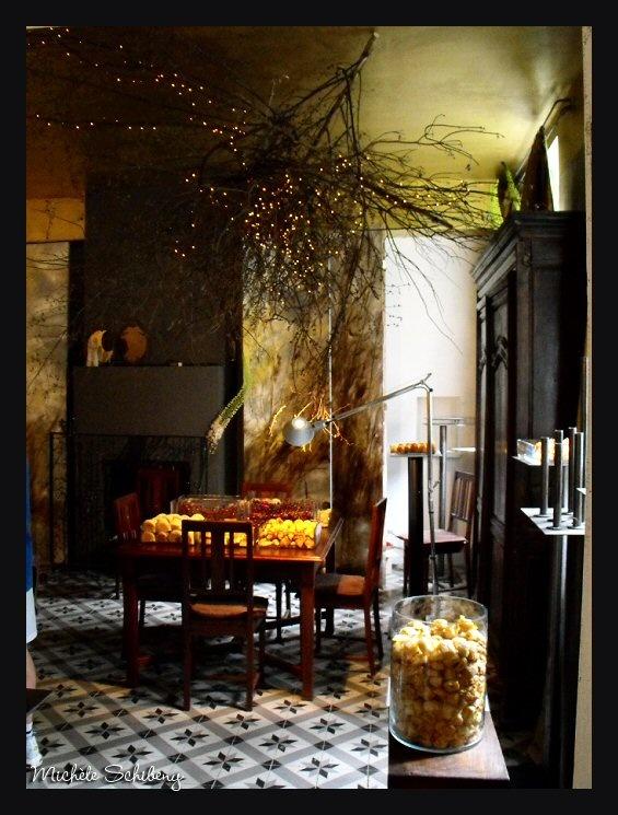 Maison de Claire Basler. Love the big branch with lights. Fabulous idea.