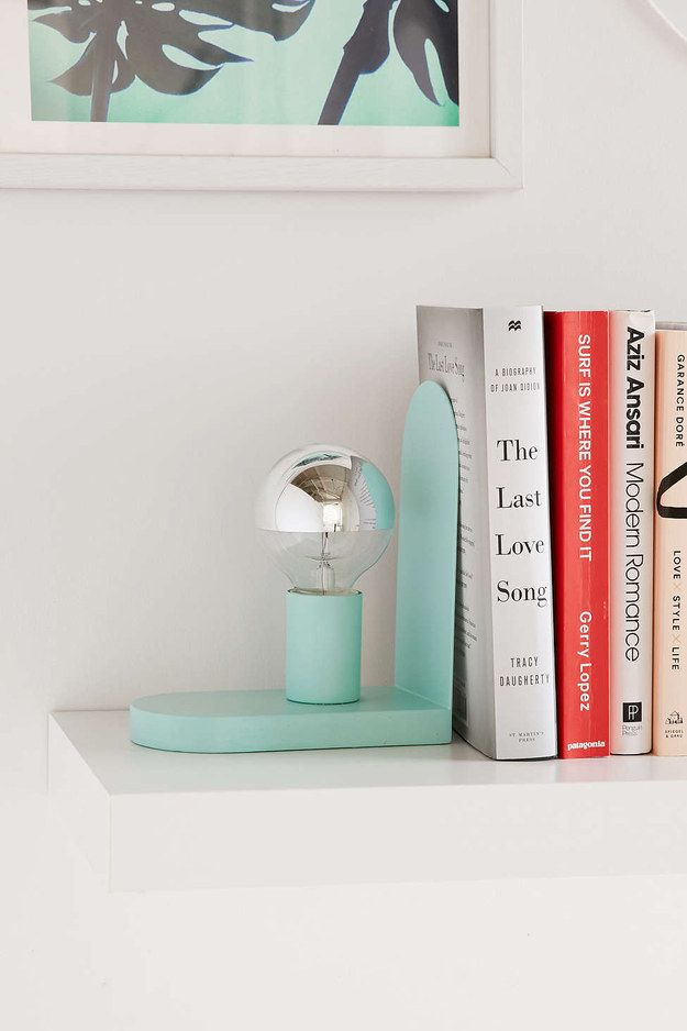 A metal bookend/reading lamp hybrid.
