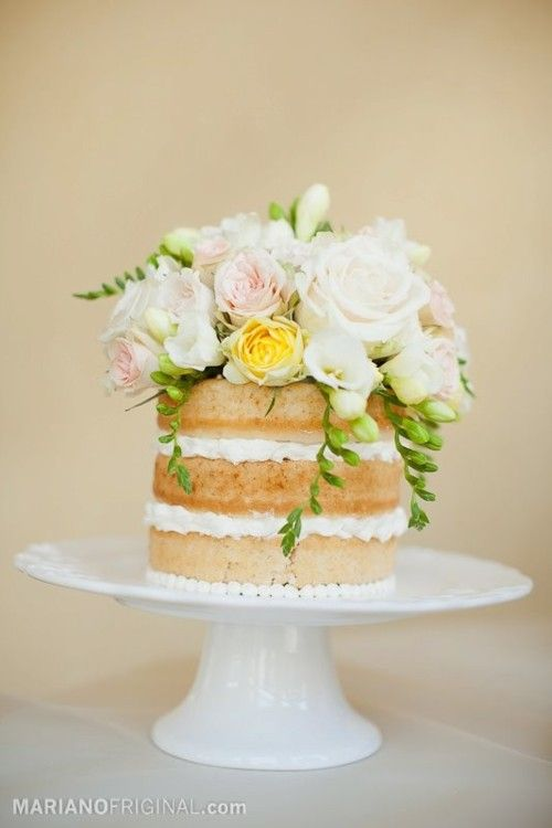 unfrosted cake w/flowers