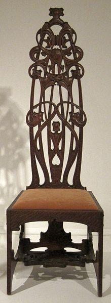 Silla de  Charles Rohlfs. 1898. Rohlfs,  norte americano es un representante del Movimiento de Artes y Oficios , y es el más famoso por su habilidad como diseñador de muebles y menaje.