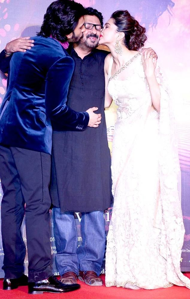 Director Sanjay Leela Bhansali being kissed by Ranveer Singh and Deepika Padukone at the first look launch of 'Ram Leela' #Bollywood #Style #Fashion