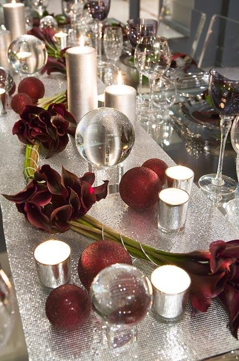 red calla lilies....silver http://trendyeventrentals.com/LOVE THE TABLESCAPE AND COLOR COMBO....NOT NECESSARILY THE FLOWER CHOICE