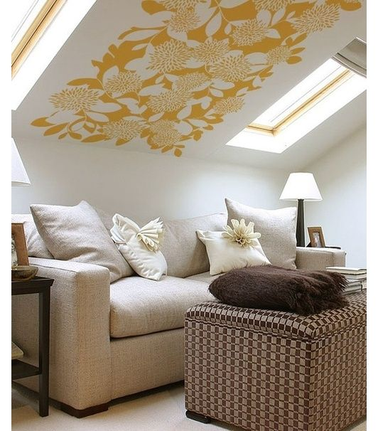 Cozy attic lounge with painted ceiling