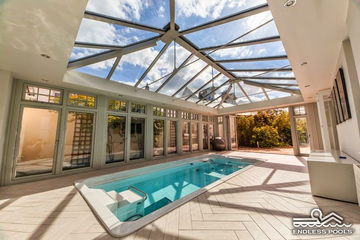 Transform your conservatory into a swimming pool? Well, ok then!   Wondering how to achieve this? why not try a Refresh Duo or glass roof with an insulating pelmet around it to create this awesome conservatory design. We love how endlesspoolsblog has converted this one! Thanks for sharing the design of this conservatory.