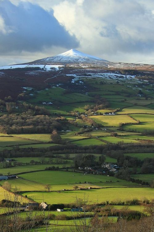 Brecon Beacons National Park and Sugar Loaf Mountain in the distance - Abergavenny, Wales, UK