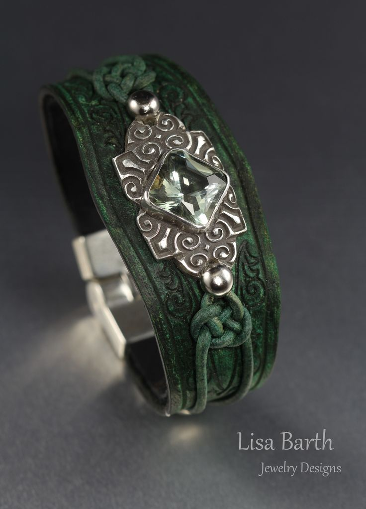 Here I bezel set a green amethyst in fine silver and hand cut, dyed and distressed the finish of the custom made leather bracelet for this centerpiece.  :)  Lisa Barth