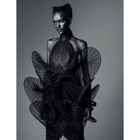 @heriethpaul wearing the #irisvanherpen dress made from laser-cut leather and hand-plissed black transparent organza that is sculptured with a soft boning into spheroid shapes.