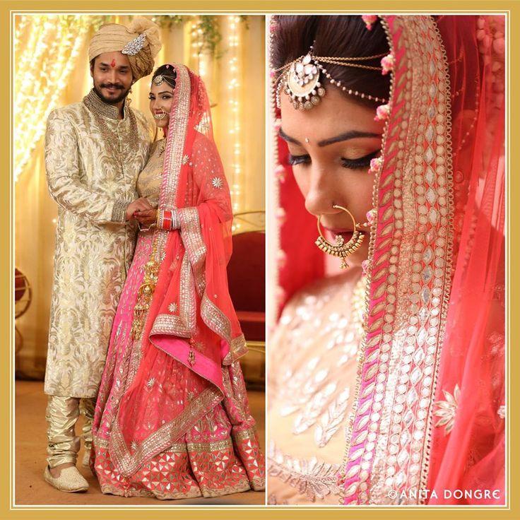The bride, Akshita Kunderan looks stunning as she joins in wearing an Anita Dongre lehenga