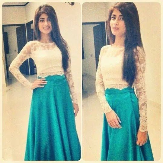Love her white lace crop top with long blue maxi skirt she looks soo beautiful love her hair when is straight.