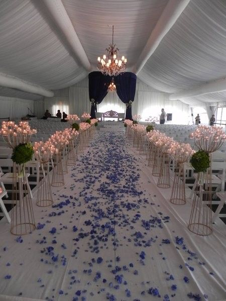 Cringe-worthy aisle runner: I've seen too many bride's heels catch on cloth and paper, but add candles to the mix. yikes!