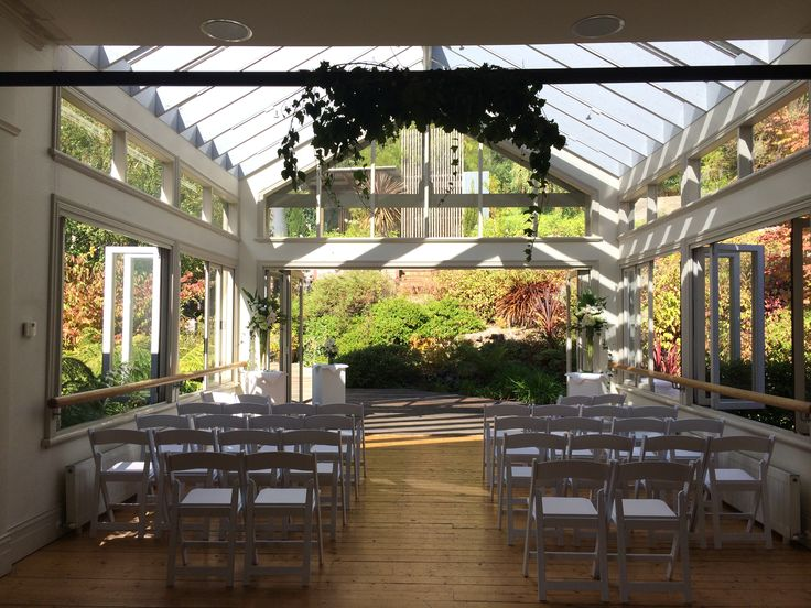 Ivy arbor with white chairs