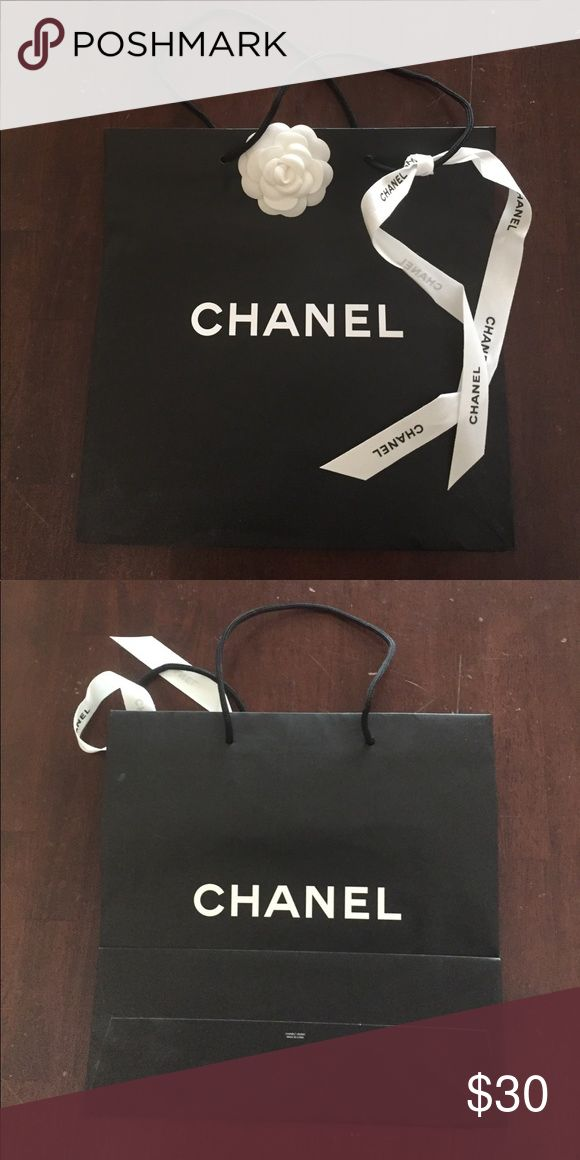 Authentic Chanel shopping bag Chanel shopping bag with ribbon and flower still attached. Bag is approximately 13x13. ❤️ CHANEL Bags