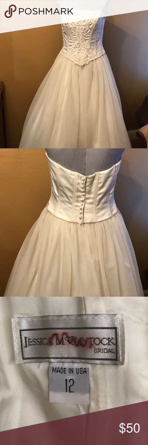 """Jessica McClintock wedding gown Ivory satin strapless bustier-style bodice with lace front. Ballerina style full skirt is layered lining, netting, lining and 2 layers of tulle. Back has covered buttons plus a zipper.  37"""" bust, 32"""" waist, 44"""" waist to hem. See photo showing marks on bodice. I purchased this way and have not attempted to clean. I never did use the dress. #104 Jessica McClintock Dresses Wedding"""