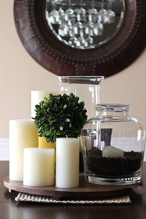 simple centerpiece...candles, jar filled with coffee beans and candle, greenery...for the kitchen