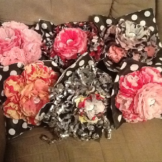 Wedding rehearsal bouquets made from bridal shower gift wrap and decorations