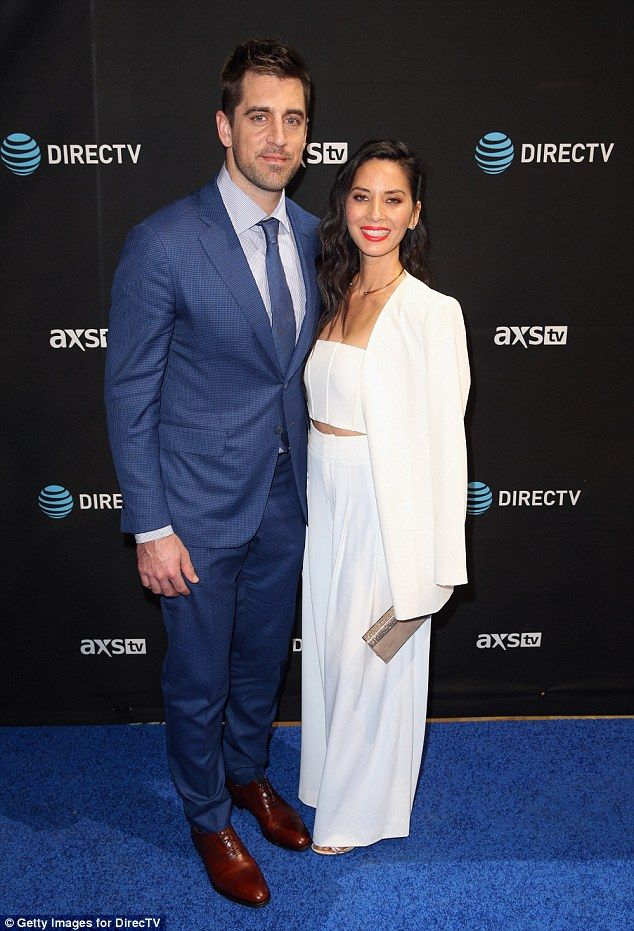 Loved up: Olivia was joined by her NFL player beau Aaron Rodgers, who she has been dating ...