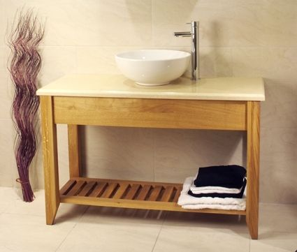 Solid European Oak double size wash stand with shelf, shown with a marble top.Our Aquarius range, Oak Furniture Solutions Online
