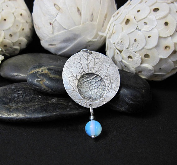 Leaf textured with domed recess and hanging moonstone by MandanaStudios