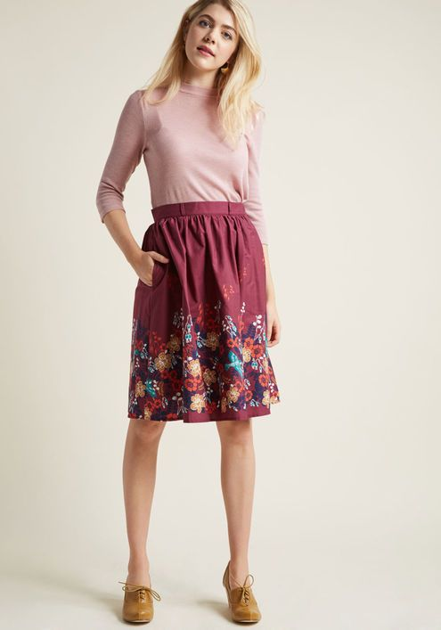 Charming Cotton Skirt with Pockets in Floral - Whoever believes staple pieces should only be solid needs to meet the sweet versatility of this burgundy skirt! A cotton offering from our ModCloth namesake label, this A-line makes it a pleasure to pair its belt loops, hidden pockets, and floral border print with your pieces both new and cherished.