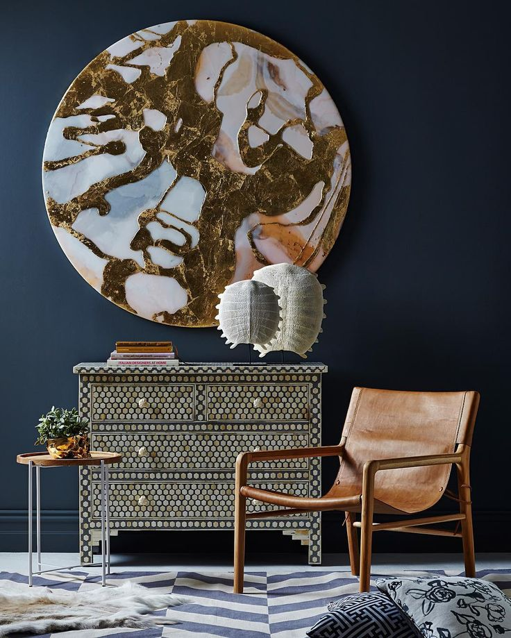 Artwork by @mwestonart our bone inlay Inverse Hexagon commode tan leather Sling chair freshwater turtle shells & @mrfentonsrugs. Paint - Stormy Blue by @haymespaint Styling - @ruthwelsby