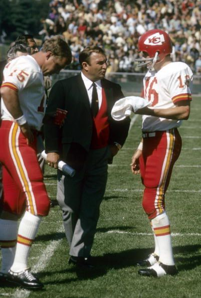 Head Coach Hank Stram of the Kansas City Chiefs talking with his quarterback Len Dawson and Jacky Lee on the sidelines