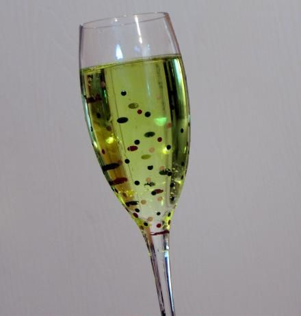 Midori Champagne Fizz from Food.com: You really only need two things to enjoy life. :)