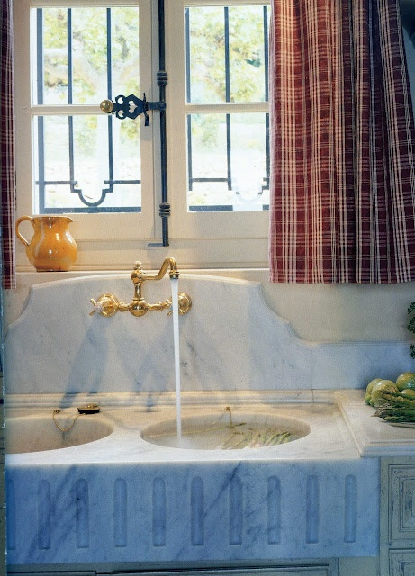 white marble double sink --- Jean-Loup Daraux home outside of Paris