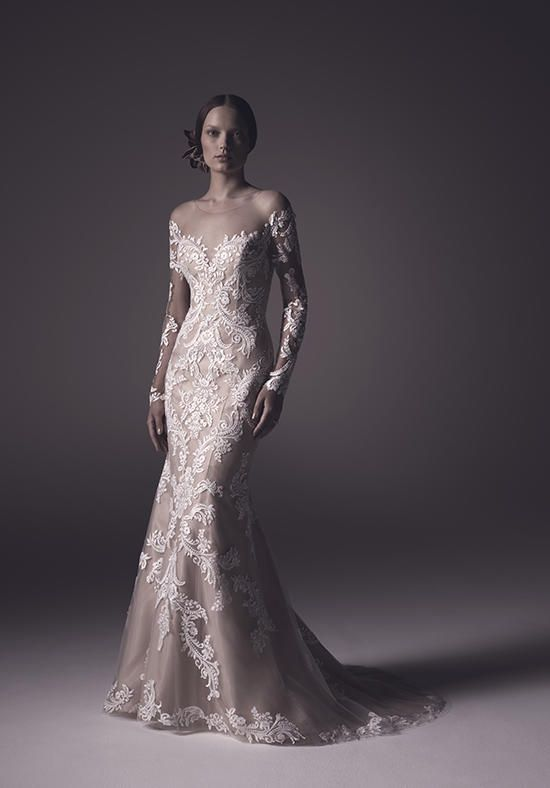 Fit-n-flare silhouette with subtle illusion neckline and long, non beaded lace sleeves | Amaré Couture by Crystal Richard | https://www.theknot.com/fashion/c110-harper-amare-couture-by-crystal-richard-wedding-dress
