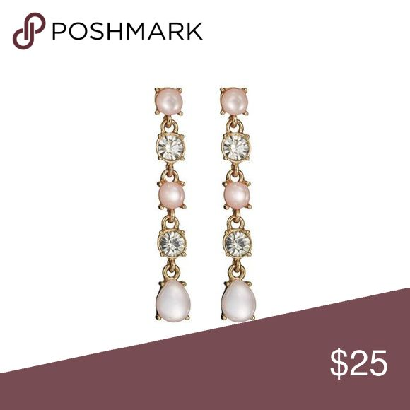 """Celestial Pink Drop Earrings Pop open the baubles and celebrate by shining bright.  FEATURES  • Round pink stones and teardrop-shaped pink stones with a clear glass stone in between • Post with bullet clutch • Earrings are 1 1/4"""" L  MATERIALS  • Imitation shiny goldtone plating • Aluminum • Titanium • Plastic • Glass • Zinc Jewelry Earrings"""
