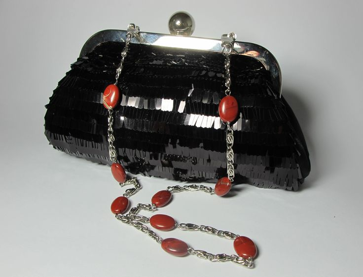 Black satin mini-clutch with pailletes and red jasper. Nickel free