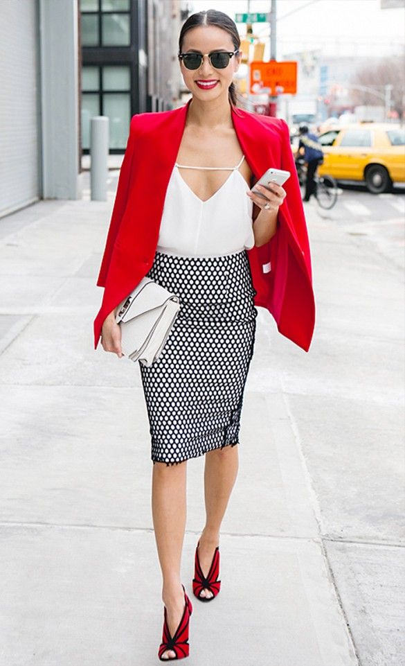Jamie Chung in a pencil skirt and white camisole with a red blazer draped over her shoulders