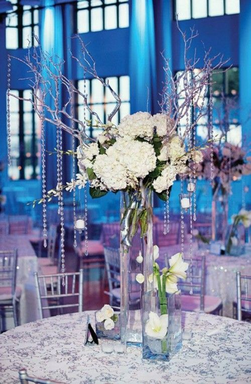 blue decor with the centerpieces having branches with silver danglies