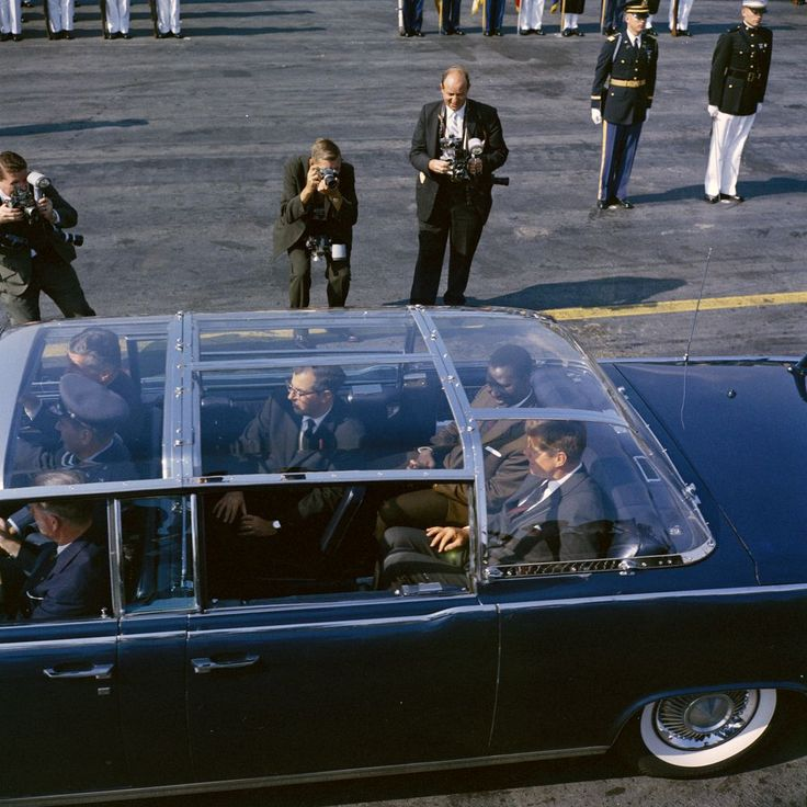 JFK in the limousine with the plexiglass top attached.