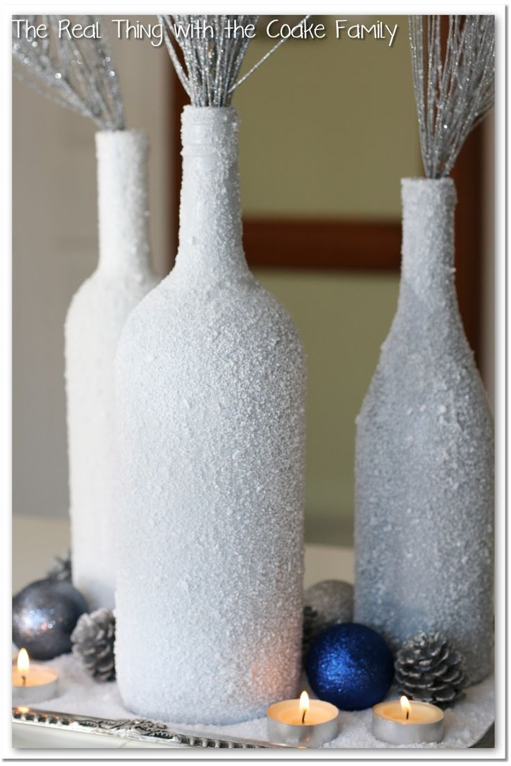 Winter Centerpiece from wine bottles and epsom salt #centerpiece @realcoake...could do on vases too?...with white or silver glitter on bottle and on black branches?