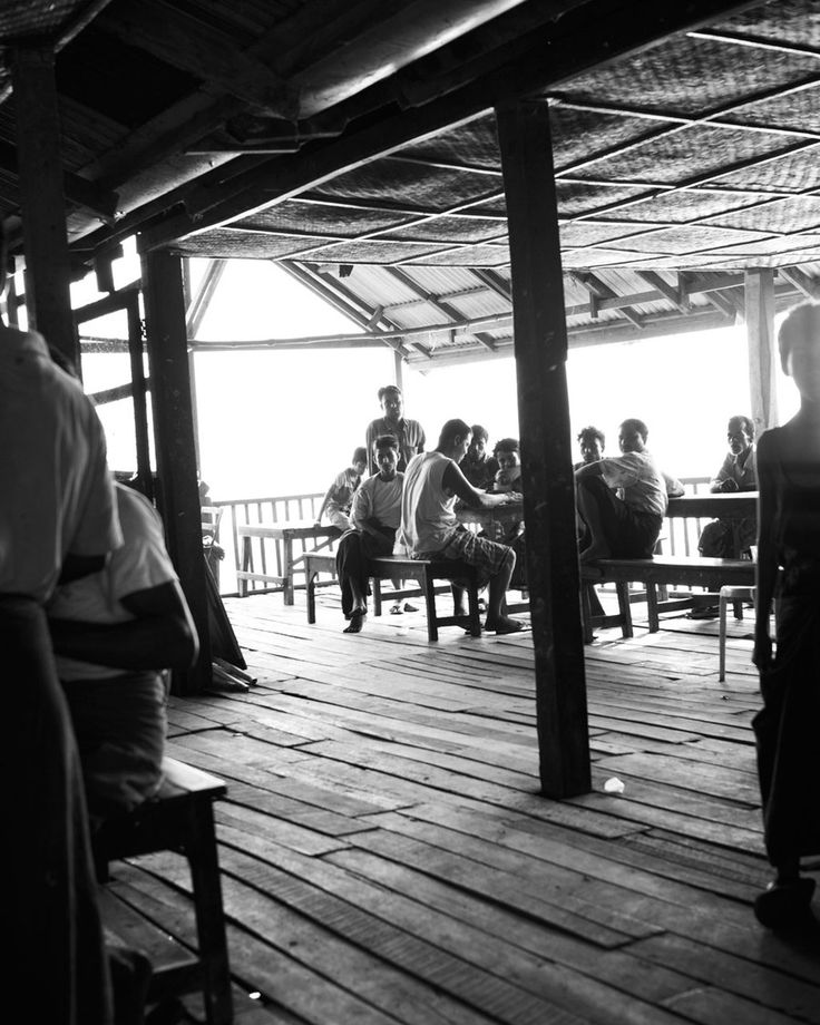 After a night on the water, squid fishermen take a break—sometimes with chai, black tea brewed with milk—at the Sittwe open-air market.