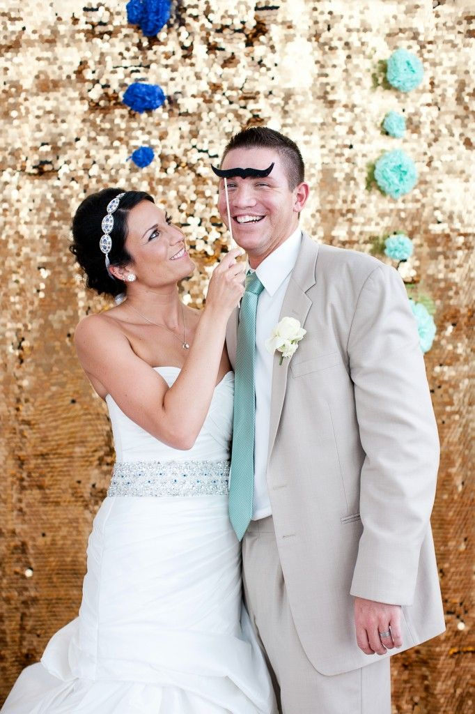 bride and groom in front of gold