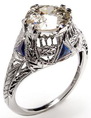 Antique Engagement Ring with Old Euro Diamond 18K White Gold 1920s.  A 1.2 carat old European cut diamond set in solid 18k white gold. This antique engagement ring dates from the 1920s and features sapphire accents and openwork details.