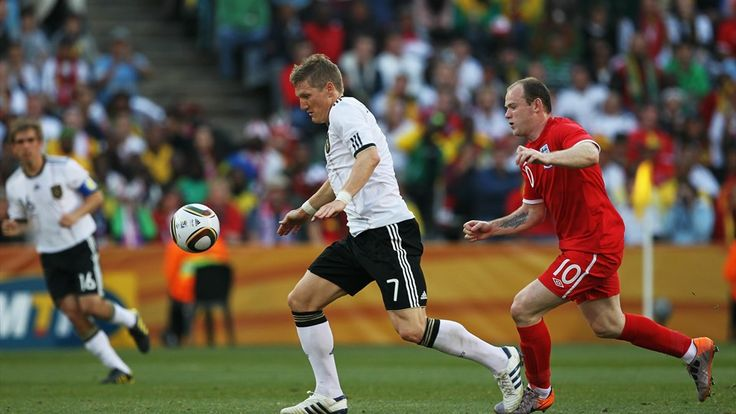 BLOEMFONTEIN, SOUTH AFRICA - JUNE 27: Bastian Schweinsteiger of Germany (L) chases the ball with Wayne Rooney of England (R) during the 2010 FIFA World Cup South Africa Round of Sixteen match between Germany and England at Free State Stadium on June 27, 2010 in Bloemfontein, South Africa. (Photo by Jamie Squire - FIFA/FIFA via Getty Images)