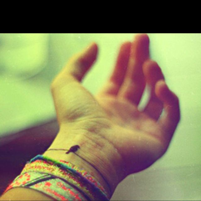 Cute bird tattoo on wrist would look cute with a wrist full of bracelets!
