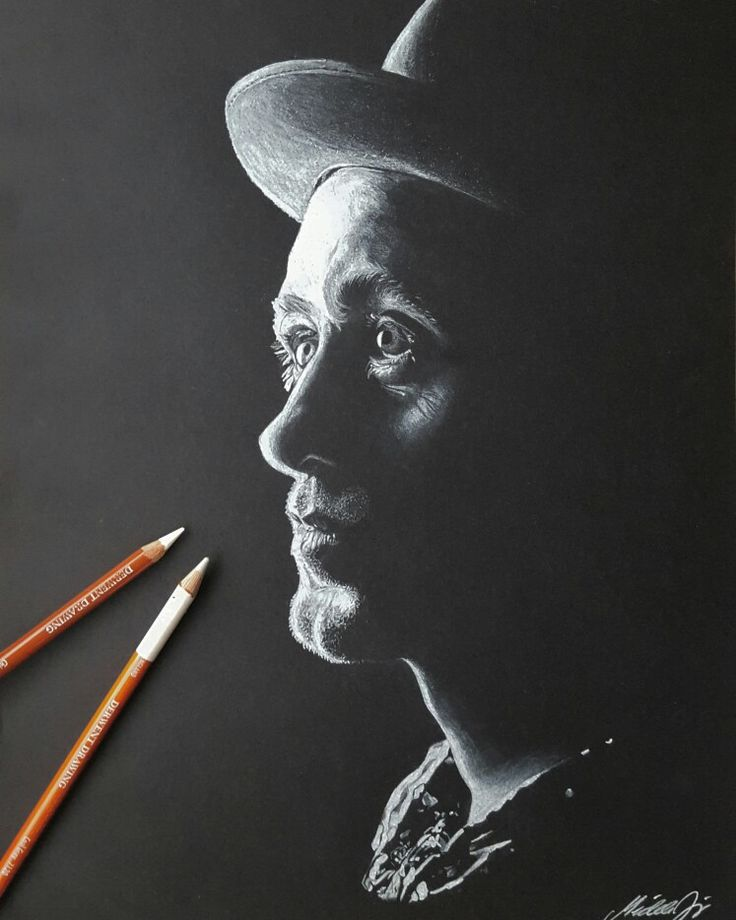 My drawing of Mark Owen from take that. Made on black paper with white pencil